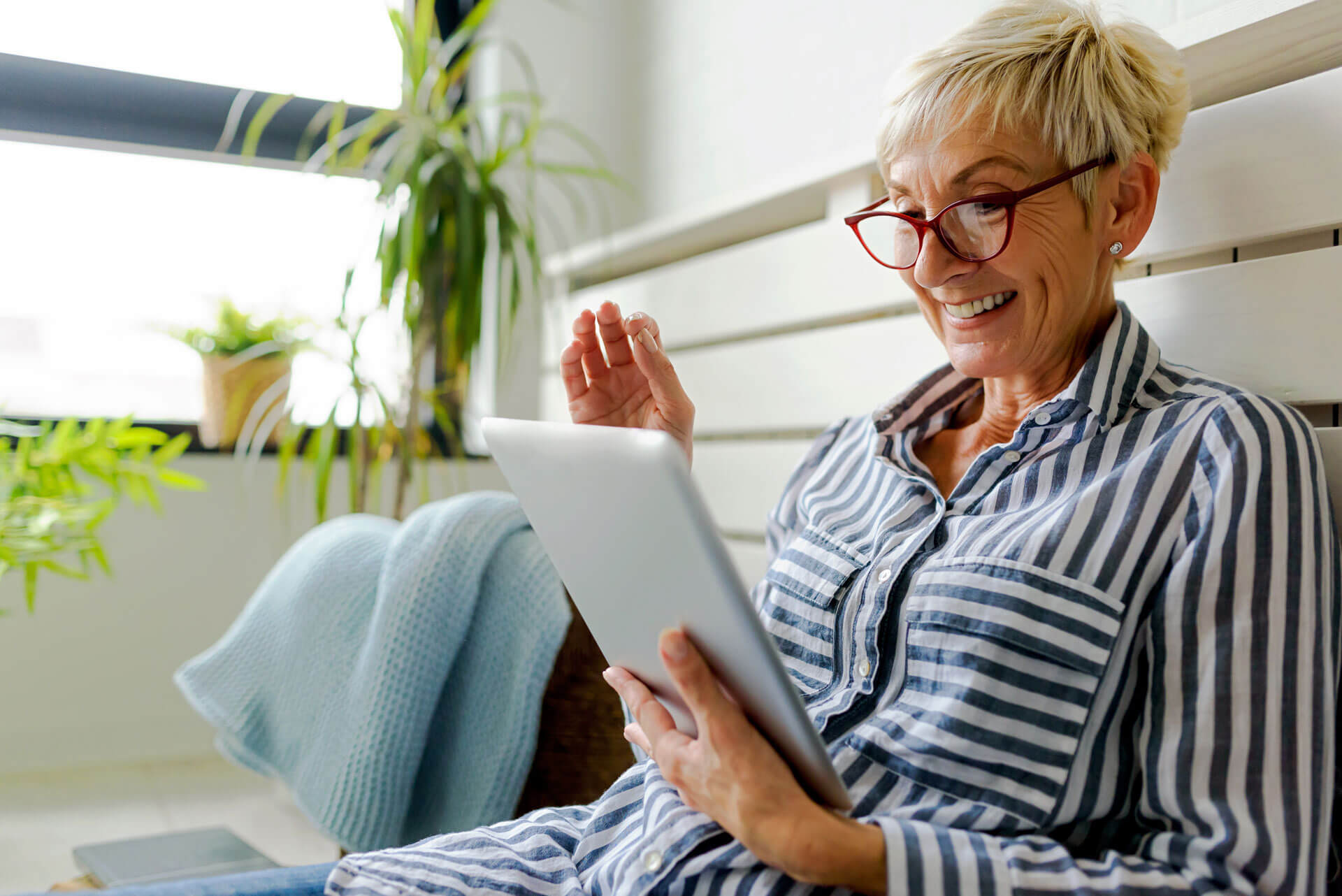 Older woman reading tablet