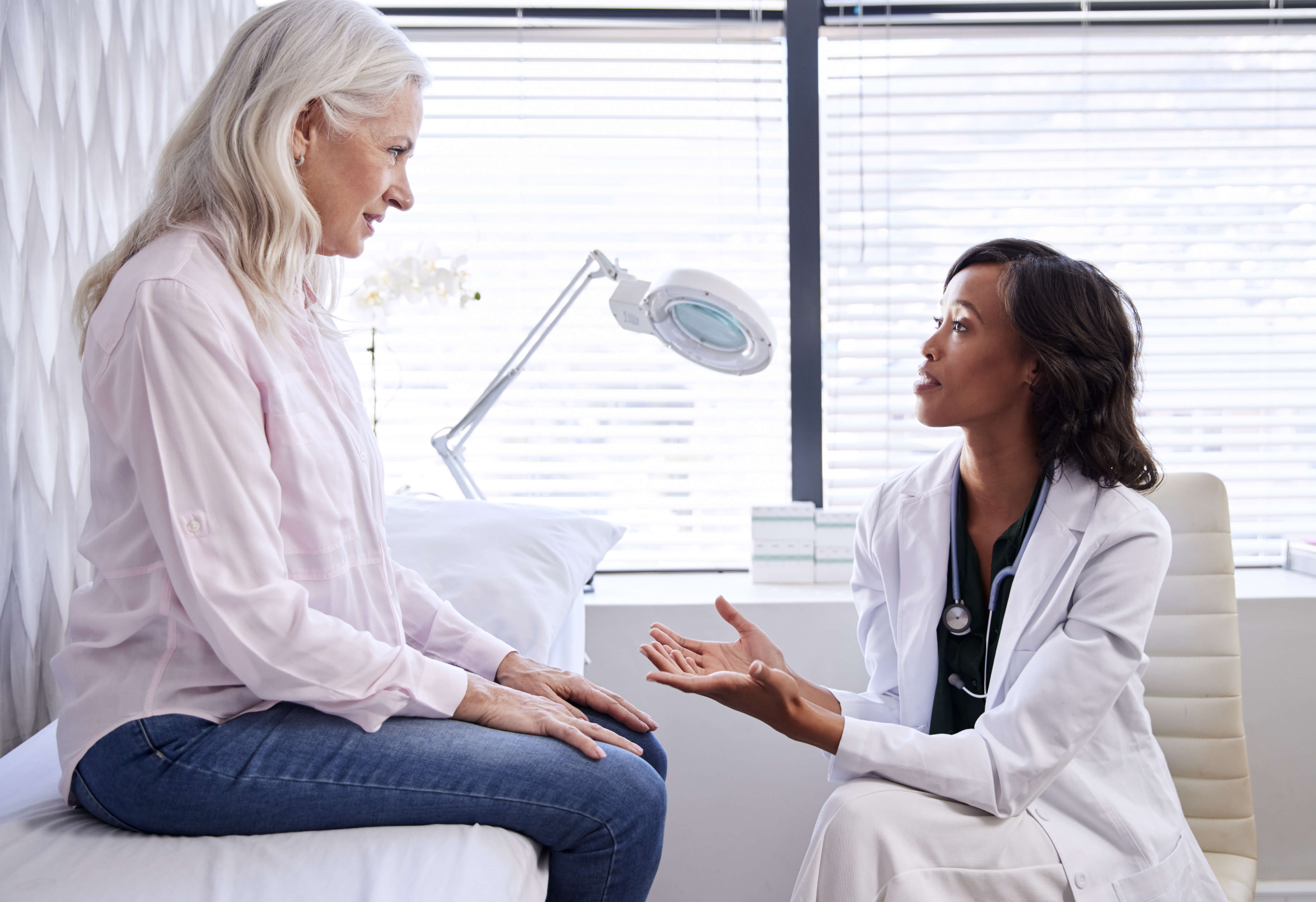 Older patience consulting with doctor