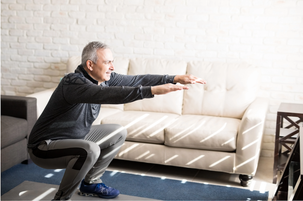 man stretching in living room