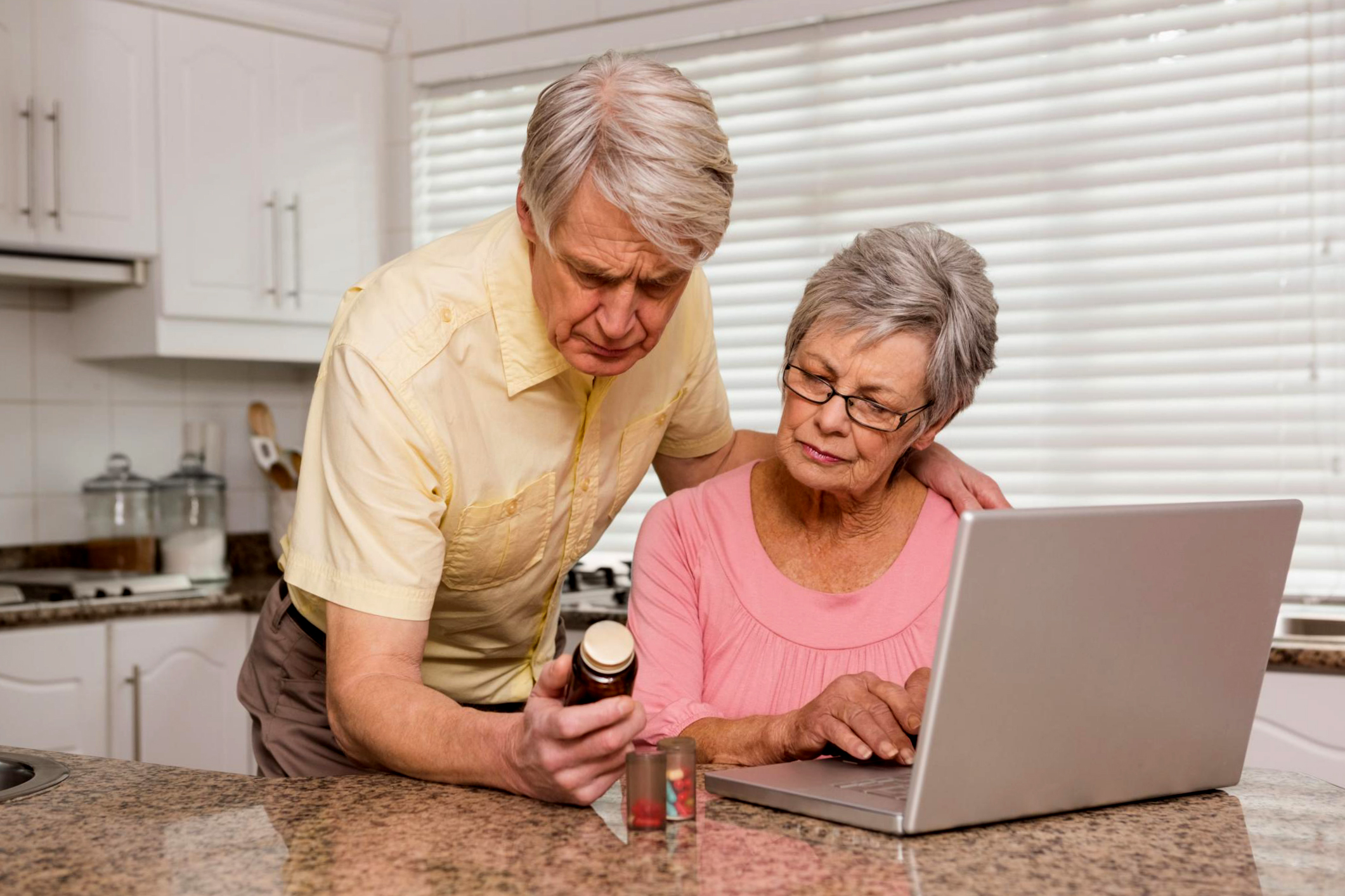 husband and wife researching supplements